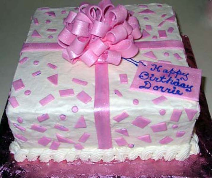 http://cakes.dqd.com/Birthdays_web/images/Gift%20wrapped.jpg